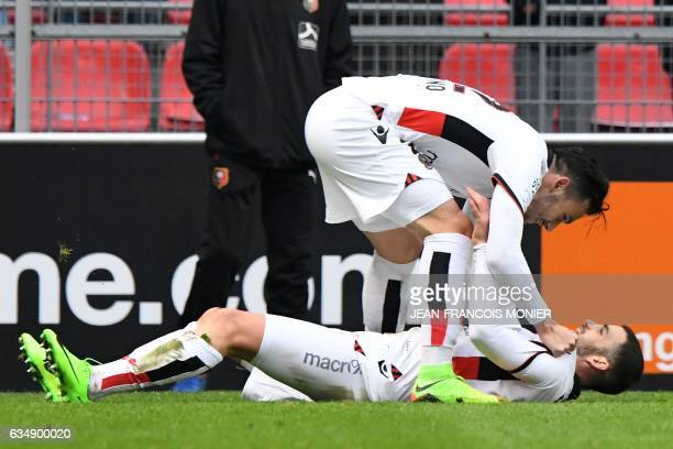 Nice's French midfielder Valentin Eysseric is congratulated by Nice's Greek forward Anastasios Donis after scoring during the French L1 football...