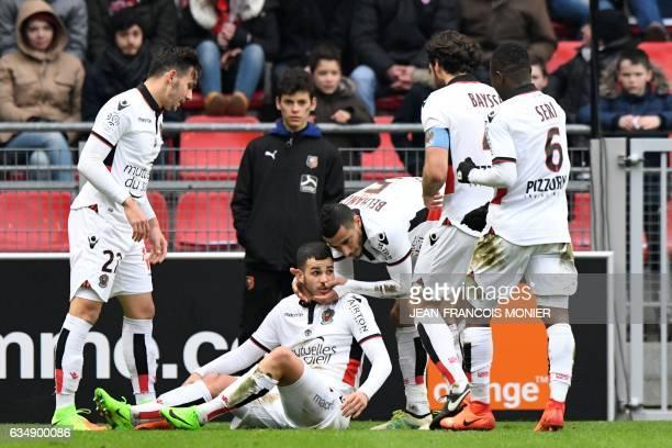 Nice's French midfielder Valentin Eysseric is congratulated by Nice's Greek forward Anastasios Donis and Nice's Frenchborn Moroccan midfielder Younes...