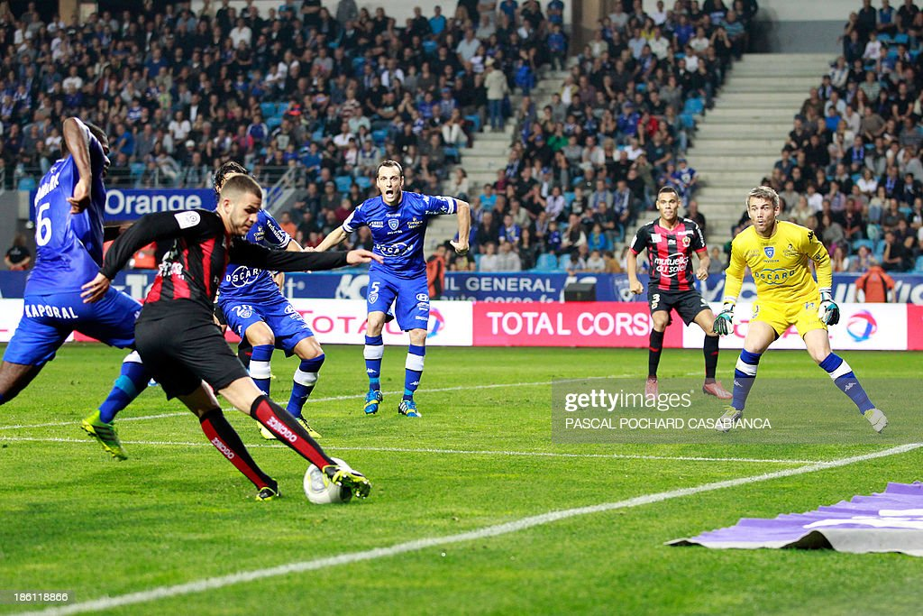 Nice's French midfielder Valentin Eysseric (L) shoots the ball during the French L1 football match Bastia (SCB) against Nice (OGC) in the Armand Cesari stadium in Bastia, Corsica, on October 26, 2013.