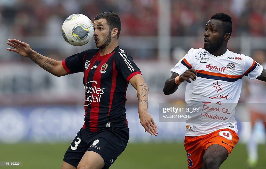 Nice's French midfielder Valentin Eysseric (L) vies with Montpellier's defender Siaka Tiene (R) during the French L1 football match between Nice and Montpellier on September 1, 2013 at the Ray stadium in Nice, southeastern France.