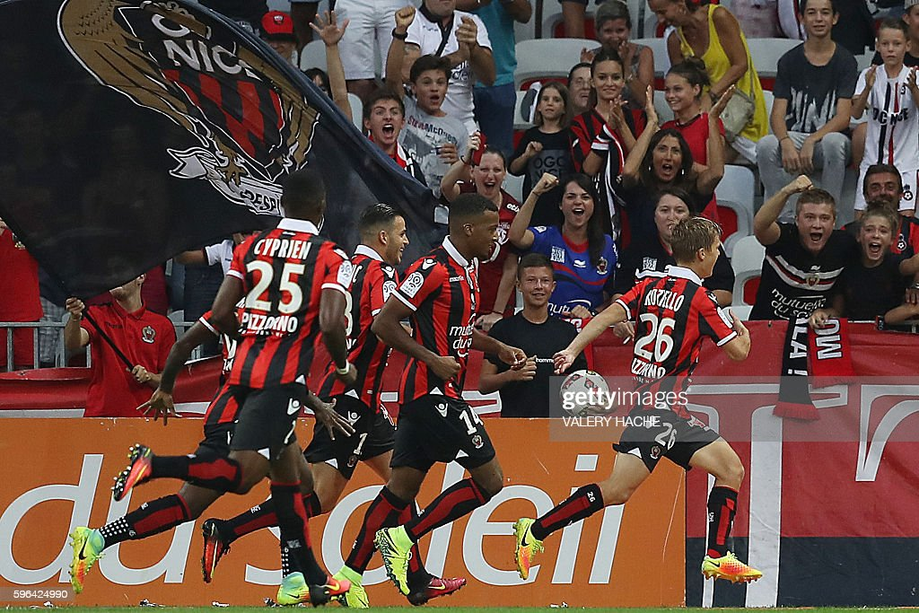 Nice's French midfielder Vincent Koziello celebrates with teammates after scoring a goal during the French L1 football match Nice vs Lille on August...
