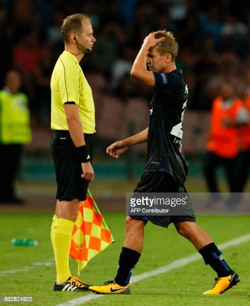 Nice's French midfielder Vincent Koziello leaves the pitch after being expelled during the UEFA Champions League Play Off first leg football match...