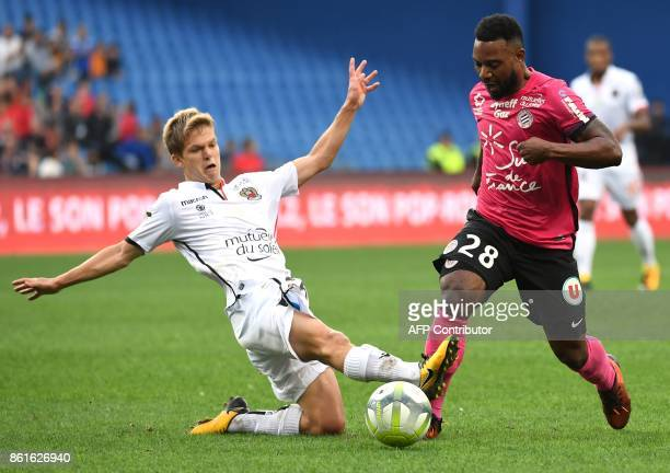 Nice's French midfielder Vincent Koziello vies with Montpellier's French midfielder Stephane Sessegnon during the French L1 football match between...
