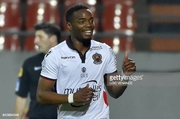 Nice's French midfielder Wylan Cyprien celebrates after scoring during the French L1 football match Lorient vs Nice at the Moustoir stadium in...