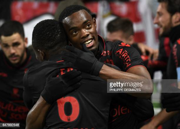 Nice's French midfielder Wylan Cyprien is congratulated by teammates after scoring a goal during the French L1 football match Dijon against OGC Nice...