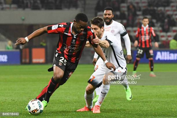 Nice's French midfielder Wylan Cyprien outruns Montpellier's French midfielder Paul Lasne during the French L1 football match OGC Nice vs Montpellier...