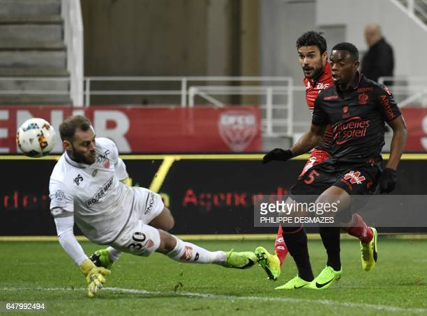 Nice's French midfielder Wylan Cyprien scores a goal during the French L1 football match Dijon against OGC Nice on March 4 2017 at the GastonGerard...