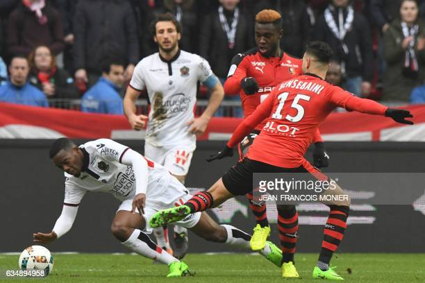 Nice's French midfielder Wylan Cyprien vies for the ball with Rennes' French defender Joris Gnagnon and Rennes'Algeria defender Ramy Bensebaini...