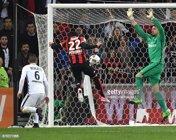 TOPSHOT Nice's Greek forward Anastasios Donis scores their third goal during the French L1 football match Nice vs Paris Saint Germain on April 30...