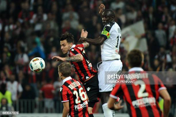Nice's Greek forward Anastasios Donis vies with Angers' Senegalese midfielder Cheikh N'Doye during the French L1 football match Nice vs Angers on May...