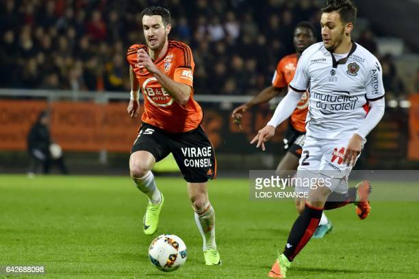Nice's Greek forward Anastasios Donis vies with Lorient's defender Mathieu Peybernes during the French L1 football match Lorient vs Nice at the...