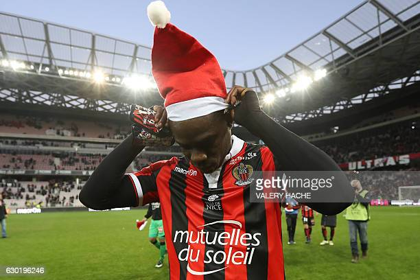 Nice's Italian forward Mario Balotelli puts a Santa Claus bonnet at the end of the French L1 football match Nice vs Dijon on December 18 2016 at the...
