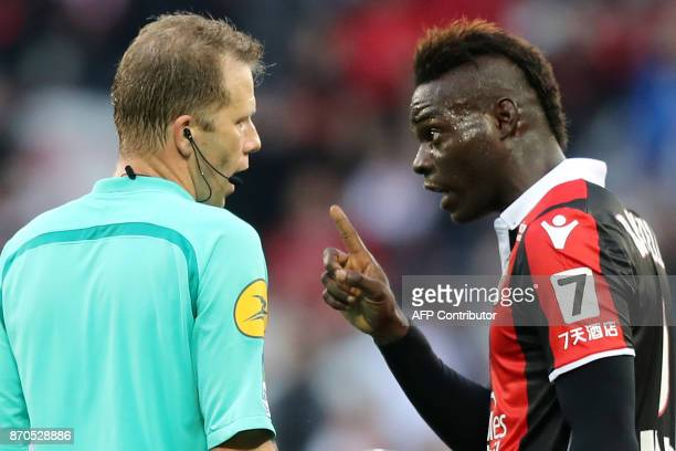 Nice's Italian forward Mario Balotelli reacts after receiving a red card by French referee Olivier Thual during the French L1 football match between...