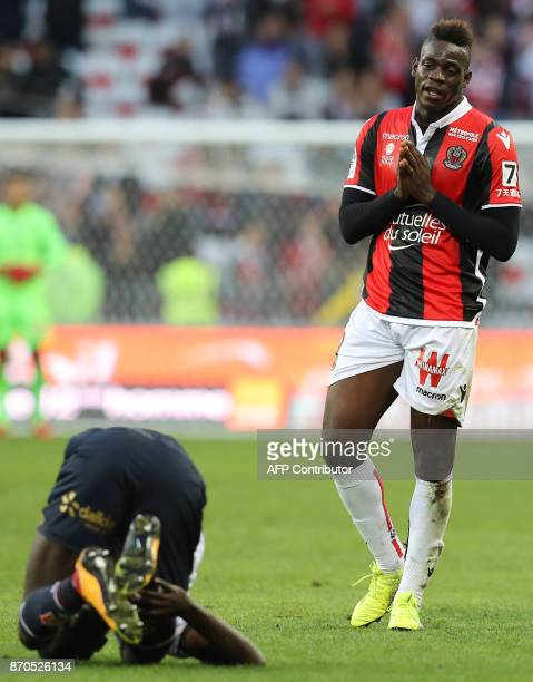 Nice's Italian forward Mario Balotelli reacts as Dijon's French defender Cedric Yambere stays on the ground during the French L1 football match...