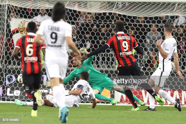 Nice's Italian forward Mario Balotelli scores a goal during the French L1 football match Nice vs Paris Saint Germain on April 30 2017 at the 'Allianz...