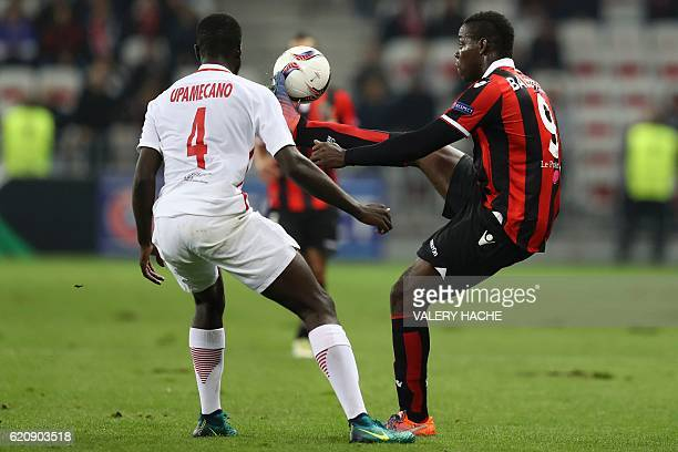 Nice's Italian forward Mario Balotelli vies for the ball with Salzburg's French defender Dayot Upamecano during the Europa League football match...