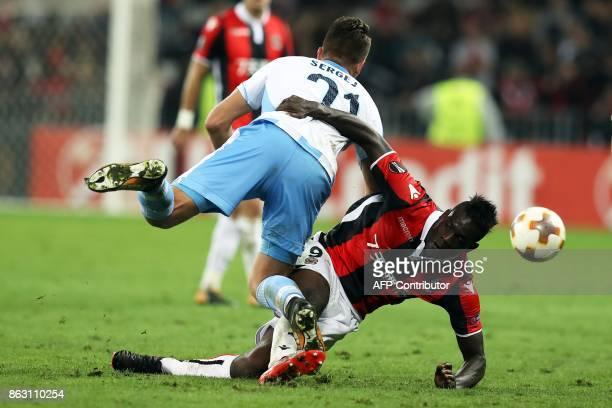 Nice's Italian forward Mario Balotelli vies with Lazio's midfielder from Serbia Sergej MilinkovicSavic during the UEFA Europa League football match...
