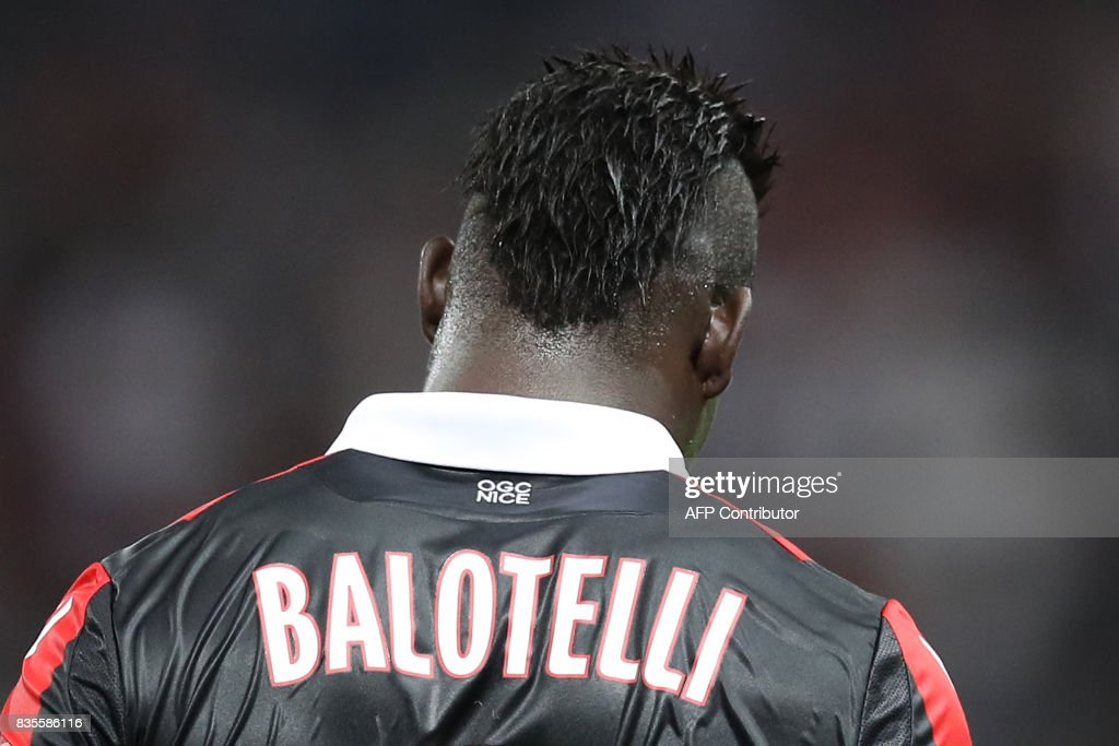 Nice's Italian forward Mario Balotelli walks during the French L1 football match Nice (OGCN) vs Guingamp (EAG) on August 19, 2017 at the 'Allianz Riviera' stadium in Nice, southeastern France. /