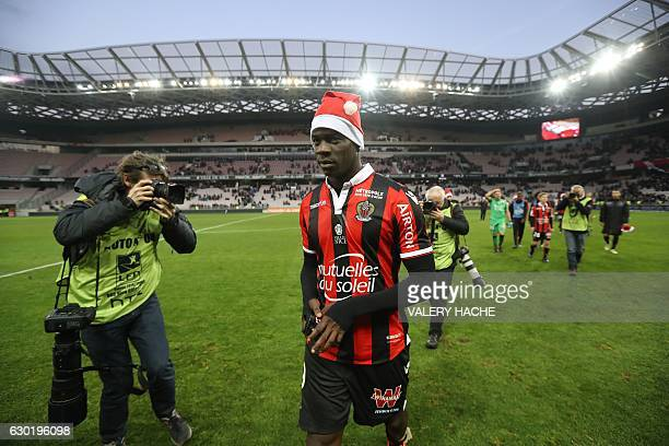 Nice's Italian forward Mario Balotelli wearing a Santa Claus bonnet walks on the pitch at the end of the French L1 football match Nice vs Dijon on...