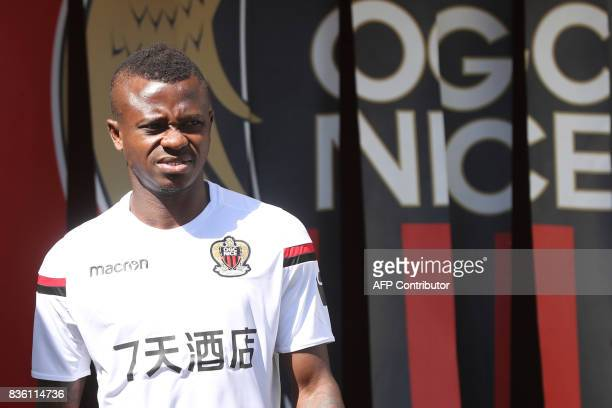 Nice's Ivorian midfielder Jean Michael Seri arrives to attend a training session on the eve of the UEFA Champions League football match between Nice...