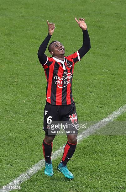 Nice's Ivorian midfielder Jean Michael Seri celebrates after scoring a goal during the French L1 football match Nice vs Lyon on October 14 2016 at...