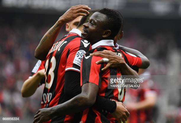 Nice's Ivorian midfielder Jean Michael Seri celebrates with his teammates after scoring a goal during the French L1 football match OGC Nice vs AS...
