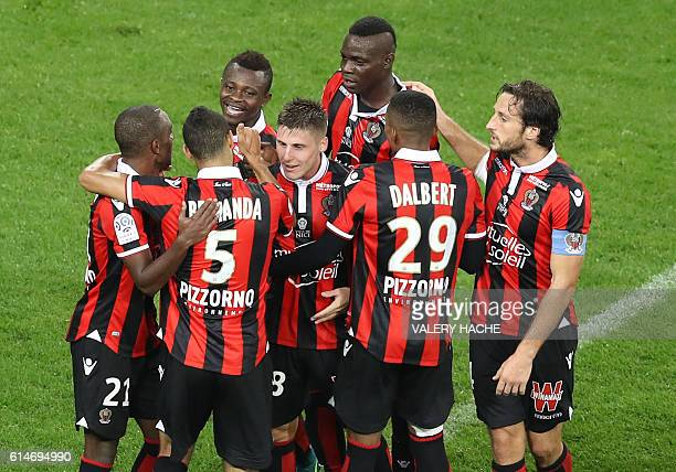 TOPSHOT Nice's Ivorian midfielder Jean Michael Seri celebrates with teammates after scoring a goal during the French L1 football match Nice vs Lyon...