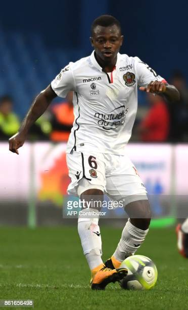 Nice's Ivorian midfielder Jean Michael Seri runs with the ball during the French L1 football match between MHSC Montpellier and Nice on October 15...