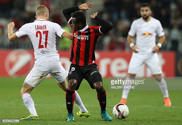 Nice's Ivorian midfielder Jean Michael Seri vies for the ball with Salzburg's Austrian midfielder Konrad Laimer during the Europa League football...