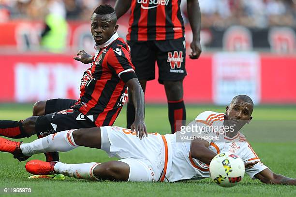 Nice's Ivorian midfielder Jean Michael Seri vies with Lorient's Portuguese midfielder Carlos Miguel Cafu during a French L1 football match between...