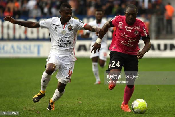Nice's Ivorian midfielder Jean Michael Seri vies with Montpellier's French defender Jerome Roussillon during the French L1 football match between...