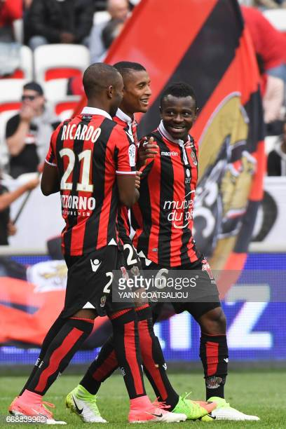 Nice's Ivorian midfielder Jean Michel Seri celebrates with his teammates after scoring a goal during the French L1 Football match between OGC Nice...