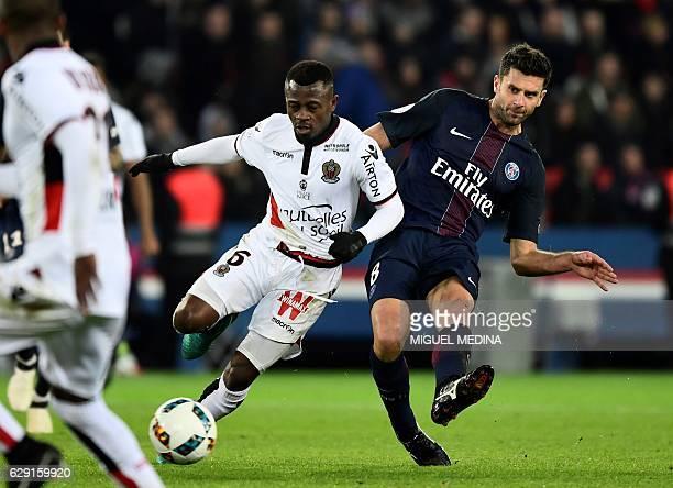 Nice's Ivorian midfielder Jean Michel Seri vies with Paris SaintGermain's Italian midfielder Thiago Motta during the French L1 football match between...