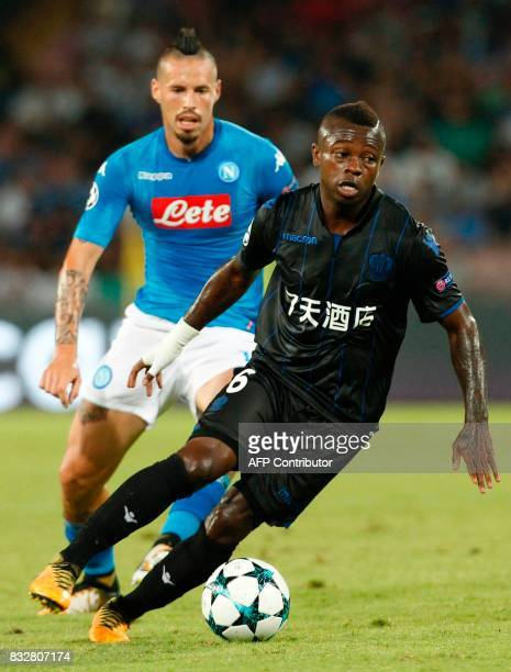Nice's Ivorian midfielder Jean Seri controls the ball near Napoli's Slovakian midfielder Marek Hamsik during the UEFA Champions League Play Off first...