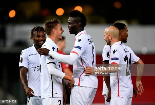 Nice's Mario Balotelli celebrates with teammates after scoring during the UEFA Europa League Group K football match between SV Zulte Waregem and OGC...