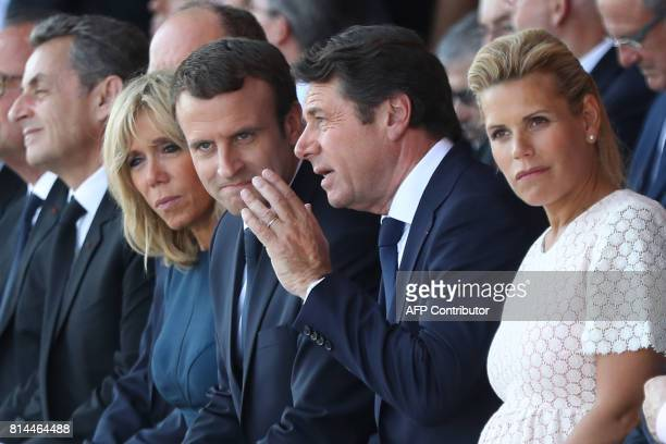Nice's Mayor Christian Estrosi speaks with French President Emmanuel Macron next to their wives Brigitte Macron and Laura Tenoudji during a...