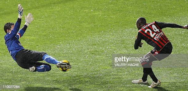Nice's midfielder Abdou Traore vies with Auxerre's goalkeeper Olivier Sorin during their French L1 football match Nice vs Auxerre on march 10 2011 at...