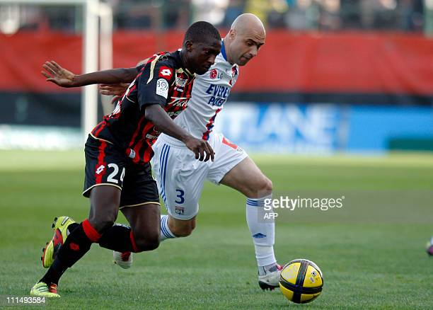 NIce's midfielder Abdou Traore vies with Lyon's defender Cristiano Marques Cris during their French L1 football match Nice vs Lyon on April 3 2011 at...