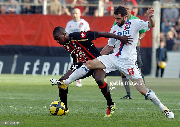 NIce's midfielder Abdou Traore vies with Lyon's forward Lisandro Lopez during their French L1 football match Nice vs Lyon on April 3 2011 at the Ray...