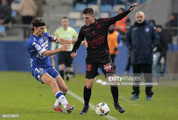 Nice's midfielder Remi Walter vies with Bastia's French midfielder Yannick Cahuzac during the L1 football match Bastia against Nice on January 20...