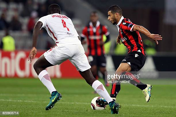 Nice's Moroccan midfielder Younes Belhanda vies for the ball with Salzburg's French defender Dayot Upamecano during the Europa League football match...