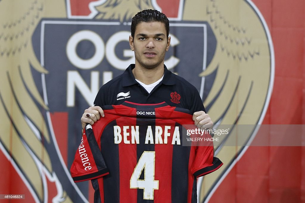 Nice's new midfielder <a gi-track='captionPersonalityLinkClicked' href=/galleries/search?phrase=Hatem+Ben+Arfa&family=editorial&specificpeople=825038 ng-click='$event.stopPropagation()'>Hatem Ben Arfa</a> (C) poses with his new jersey during his official presentation, on January 5, 2015 at the 'Allianz Riviera' stadium in Nice, southeastern France. The Ligue 1 side said on January 3, that they have agreed a deal with the 27-year-old, who returned to Newcastle after failing to make an impact during a loan spell at Hull City earlier this season.