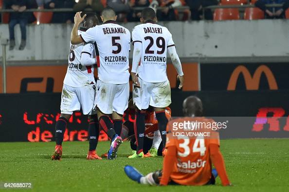 Nice's players celebrate after winning the French L1 football match Lorient vs Nice at the Moustoir stadium in Lorient western France on February 18...