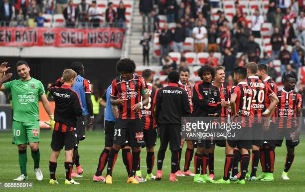 Nice's players celebrate at the end of the French L1 Football match between OGC Nice and AS Nancy Lorraine at the Allianz Riviera Stadium in Nice on...