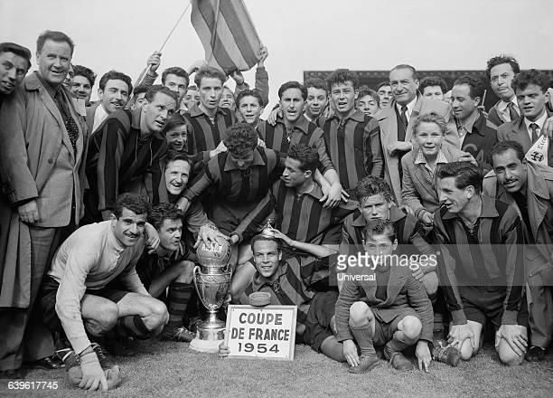 Nice's players celebrate with trophy after their victory over Marseille in the 1954 French Cup final