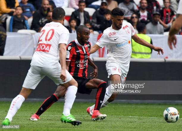 Nice's Portuguese defender Ricardo Pereira vies with Nancy's French midfielder Youssef Ait Bennasser during the French L1 Football match between OGC...