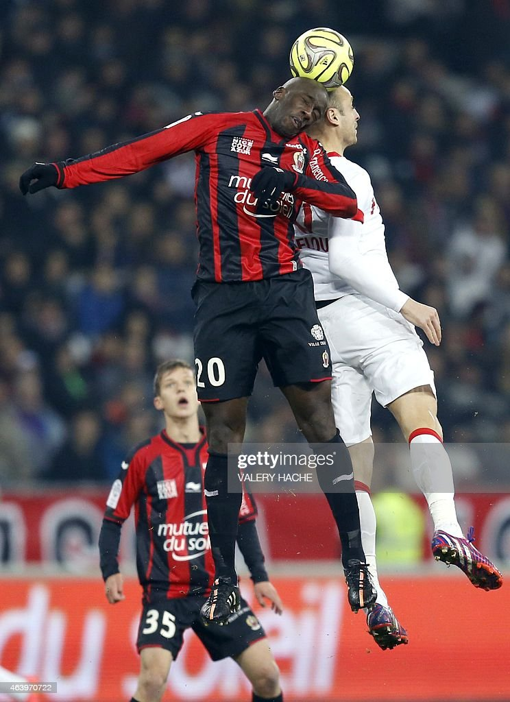 Nice's Senegalese midfielder <a gi-track='captionPersonalityLinkClicked' href=/galleries/search?phrase=Souleymane+Diawara&family=editorial&specificpeople=695613 ng-click='$event.stopPropagation()'>Souleymane Diawara</a> (L) vies with Monaco's Bulgarian forward <a gi-track='captionPersonalityLinkClicked' href=/galleries/search?phrase=Dimitar+Berbatov&family=editorial&specificpeople=216379 ng-click='$event.stopPropagation()'>Dimitar Berbatov</a> (R) during the French L1 football match Nice (OGC Nice) vs Monaco (ASM) on february 20, 2015 at the Allianz Riviera stadium in Nice, southeastern France.