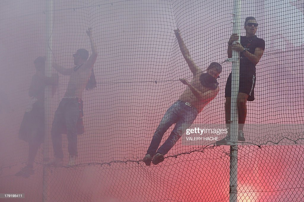 Nice's supporters react during the French L1 football match between Nice and Montpellier on September 1, 2013 at the Ray stadium in Nice, southeastern France.
