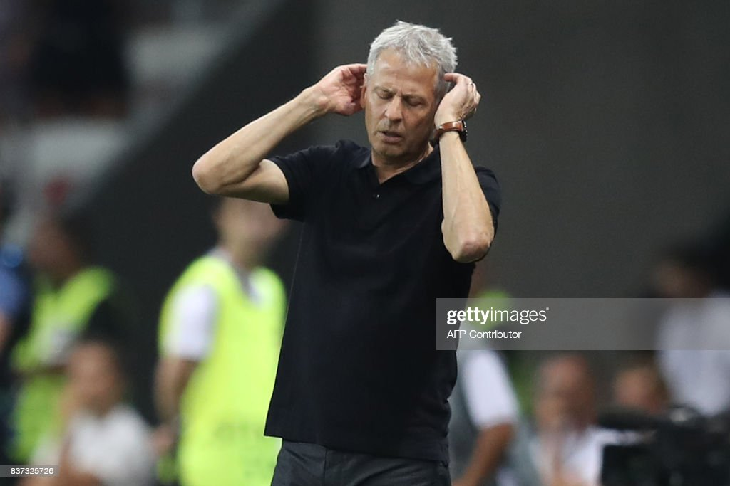 Nice's Swiss coach Lucien Favre reacts after the UEFA Champions League play-off football match between Nice and Napoli at the Allianz Riviera stadium in Nice, southeastern France, on August 22, 2017. /