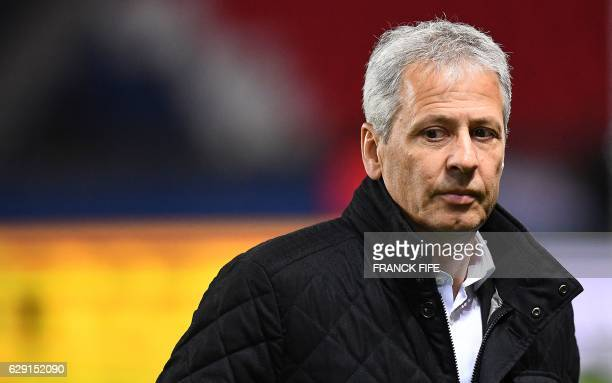 Nice's Swiss head coach Lucien Favre walks across the pitch before the French L1 football match between Paris SaintGermain and Nice at the Parc des...
